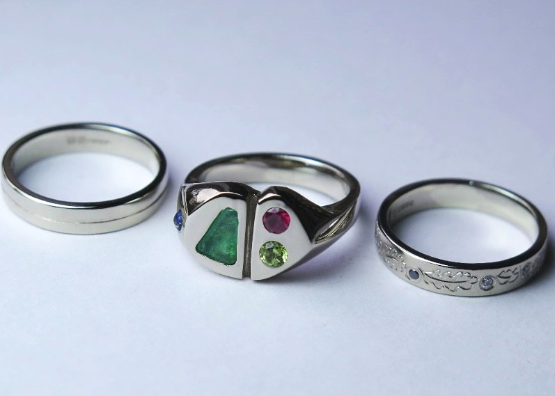 white gold, story rings, anniversary, stone set rings, coloured stones, diamond, black diamond, peridot, emerald, ruby, lapiz, emerald, hand engraved, oak leaves, engraved