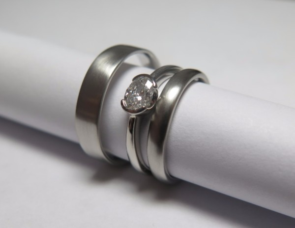 bespoke platinum and diamond engagement ring and platinum wedding rings